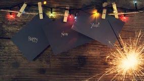 ` S Нового Года, предпосылка рождества с бенгальскими огнями рождества и игрушками рождественской елки скопируйте космос карточка Стоковая Фотография RF
