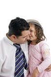 女儿耳朵父亲他s耳语 免版税库存照片
