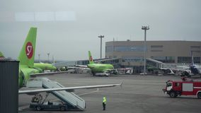 S7 airliners and fire engine at Moscow Domodedovo airport. 12.12.2015 stock video