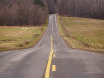 It's all down hill. Looking down hill on a country road royalty free stock photography