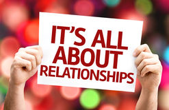 It's All About Relationships card with colorful background with defocused lights stock photos