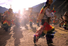 S. American festival. Danzaq dancers in the Fiesta Pentecostes near the Incan town of Ollantaytambo (Sacred Valley), Peru Stock Photography