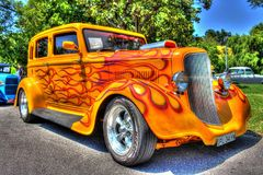 1930s American Plymouth hot rod. 1930s yellow with orange flames American Plymouth hot rod on display at the 2018 Victorian Hot Rod and Cool Rides car show in Royalty Free Stock Photos