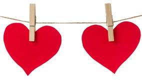 S'arrêter de papier rouge de deux coeurs image stock