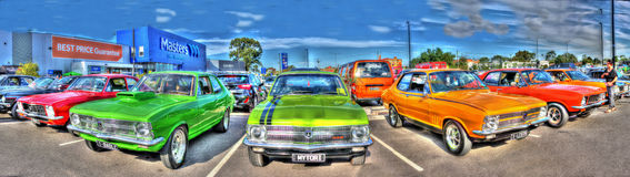 1970s Australian car panorama. 1970s Australian Holden Torana's on display in a shopping centre car park . Every weekend many car and bike shows are held in royalty free stock image