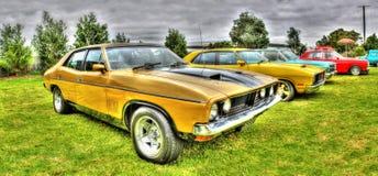 1970s Australian Ford hardtop. 1970s yellow and black Australian built Ford hardtop at car show in Melbourne, Australia royalty free stock image