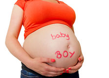 It's a baby boy. Pregnant woman with baby boy sign on the belly Royalty Free Stock Images