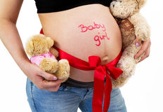 It's a baby girl!. Baby girl sign on mother belly Stock Photo