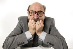 60s bald senior office boss man furious and angry gesturing upse Stock Photography