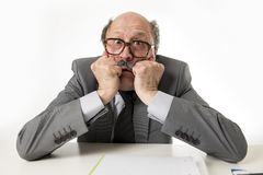 60s bald senior office employee man furious and angry gesturing Stock Images