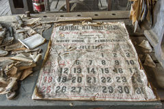 1950's bank calendar. Rockhill, PA, USA - May 21, 2016 : Relics from 1950's including bank calendar old railroad workroom royalty free stock photography