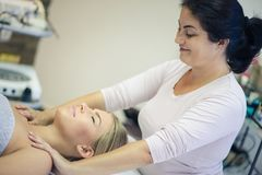 She`s the best masseuse!. Woman at a massage in spa center. Close up. Copy space stock photos