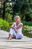 20s blond girl dreaming in the sun relaxing outdoors Royalty Free Stock Images