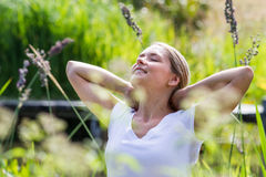 20s blond girl enjoying sun and free time in summer Royalty Free Stock Images