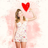 50s blond pin-up girl painting red love heart Royalty Free Stock Photography