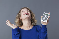 20s blonde girl thrilled at financial situation Stock Images