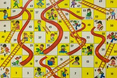1980s Board Games - Chutes and Ladders. WOODBRIDGE, NEW JERSEY - October 13, 2018: A circa 1980s board game of Chutes and Ladders is shown royalty free stock photography