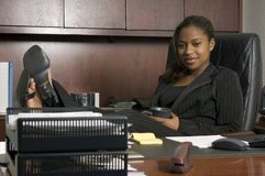 She's the boss. African-american business woman on the phone Stock Photography