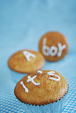 It's a boy. Muffins with It's a boy inscription on it on a blue background Stock Photos