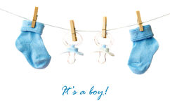 It's a boy!. Baby socks and pacifiers on the clothesline Stock Image