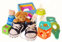 It`s a boy !. Baby boy`s shoes with pregnancy ,teddy bear and toys isolated on white Royalty Free Stock Image