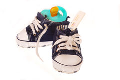 It`s a boy !. Baby boy`s shoes with pregnancy test and dummy isolated on white Stock Photo