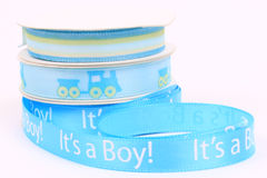 It's a boy 3. Blue ribbon with white letters saying it's a Boy! with train and blue and yellow ribbon Stock Photo