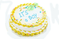 It's a boy festive cake. It's a boy, yellow and white frosted festive cake Royalty Free Stock Photo