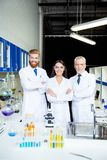 It`s a breakthrough! Successful group of three scientists are sm Royalty Free Stock Image