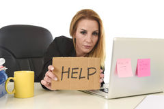 40s businesswoman holding help sign working desparate suffering Royalty Free Stock Photography
