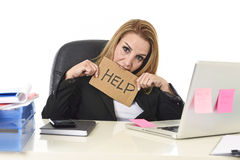 40s businesswoman holding help sign working desparate suffering Royalty Free Stock Photos
