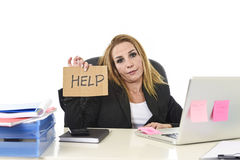 40s businesswoman holding help sign working desparate suffering Stock Image