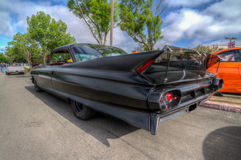 1960 s Cadillac murdered out Race Car Stock Image