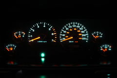 90s car cluster at night Royalty Free Stock Photos