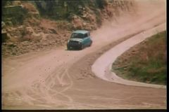 1970s car driving on dirt road
