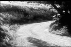 1940s car stopping on side of country road stock footage