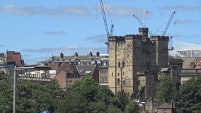 15s castle and city. A view on an ancient castle and the city of Newcastle upon tyne stock video footage