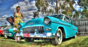 1950s Chevy and woman Royalty Free Stock Images