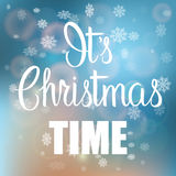 It's Christmas Time handwritten text on blurred background. Royalty Free Stock Photos