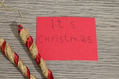 It`s christmas write on a red paper with decorations stock images