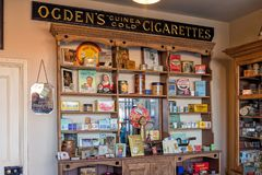 1930s Cigarette Packets and Smoking Accessories. A cabinet displaying a variety of well known cigarette and tobacco brands together with smoking accessories Stock Images
