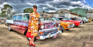 1950s Classic American Chevy with lady owner. 1950s Classic American Chevy with woman in 50s style fashion and hairdo stock image
