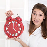 It's for a clock - young woman is happy - its leisure time Stock Photo