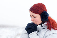 It`s so cold outside. Portrait of a beautiful lady feeling cold on wintertime Royalty Free Stock Images
