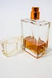 ` S Colonia degli uomini ` S Colonia degli uomini su un fondo bianco Colonia il colore del cognac Fotografie Stock