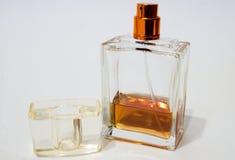 ` S Colonia degli uomini ` S Colonia degli uomini su un fondo bianco Colonia il colore del cognac Fotografia Stock Libera da Diritti