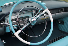 American classic car interior. 1950s convertible american classic car interior in white and light blue including dashboard and steering wheel Cadillac Eldorado Stock Image