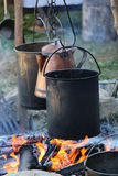 1800`s cooking pots over a fire. Campfire and cooking pots from pioneer era Royalty Free Stock Images