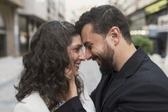 30s couple in the street in love hug royalty free stock image