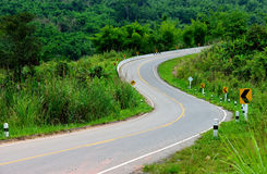 The S curve road. The S curve asphalt road is go up to the hill Royalty Free Stock Photography